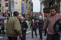 Local residents walk outside the Lungshan Temple, also known as Mengchia Temple, in Taipei, Taiwan, 2015. The temple is located in Wanhua District, formerly called Mengchia, which was one of the earliest commercial districts in Taipei.