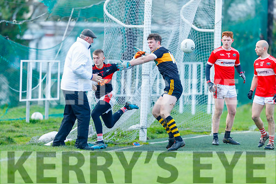 Stacks Fiachra Mangan put the Dingle keeper Deividas Uosis under pressure as the umpire keeps a watchful eye on proceedings in the Division 1 County Football league play off game in Connolly Park on Sunday.