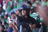United States fans are surrounded by Mexican police officers in riot gear to separate them from the  Mexican fans at Azteca stadium. The United States Men's National Team played Mexico in a CONCACAF World Cup Qualifier match at Azteca Stadium in, Mexico City, Mexico on Wednesday, August 12, 2009.