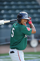 Infielder Deiner Lopez (5) of the Greenville Drive during a preseason workout on  Wednesday, April 8, 2015, the day before Opening Day, at Fluor Field at the West End in Greenville, South Carolina. (Tom Priddy/Four Seam Images)