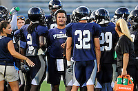 12 August 2011:  FIU Assistant Coach Todd Orlando speaks with his players during a scrimmage held as part of the FIU 2011 Panther Preview at University Park Stadium in Miami, Florida.