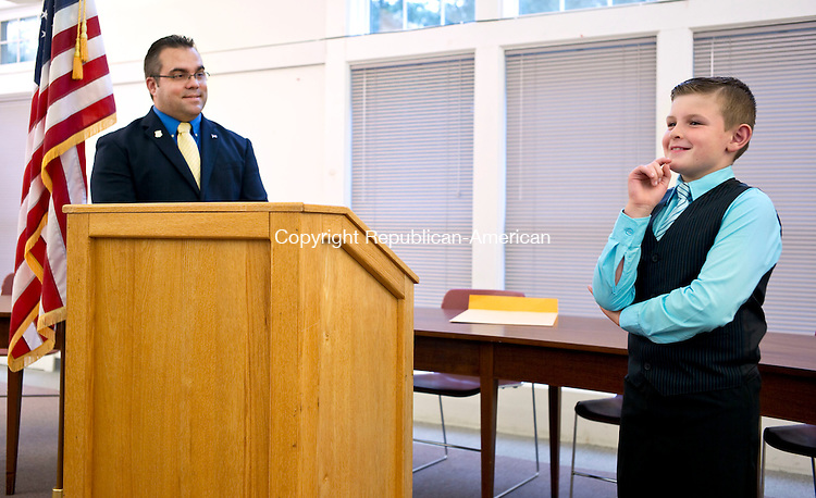 "Harwinton, CT- 30 September 2015-093015CM14- Chad Edmond, 8, of Harwinton, answers a question at the Harwinton Town Hall on Wednesday.  Looking on is Harwinton First Selectman, Michael Criss.  Edmond was named ""Selectman of the Day"" after participating in the summer program, ""Readers are Leaders"".     Christopher Massa Republican-American"