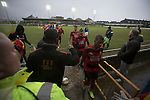 Visiting players leaving the pitch after Port Talbot Town (in blue) played against Caerau Ely in a Welsh Cup fourth round tie at the Genquip Stadium, formerly known as Victoria Road. Formed by exiled Scots in 1901 as Port Talbot Athletic, they competed in local and regional football before being promoted to the League of Wales  in 2000 and changing their name to the current version a year later. Town won this tie 3-0 against their opponents from the Welsh League, one level below the welsh Premier League where Port Talbot competed, watched by a crowd of 113.