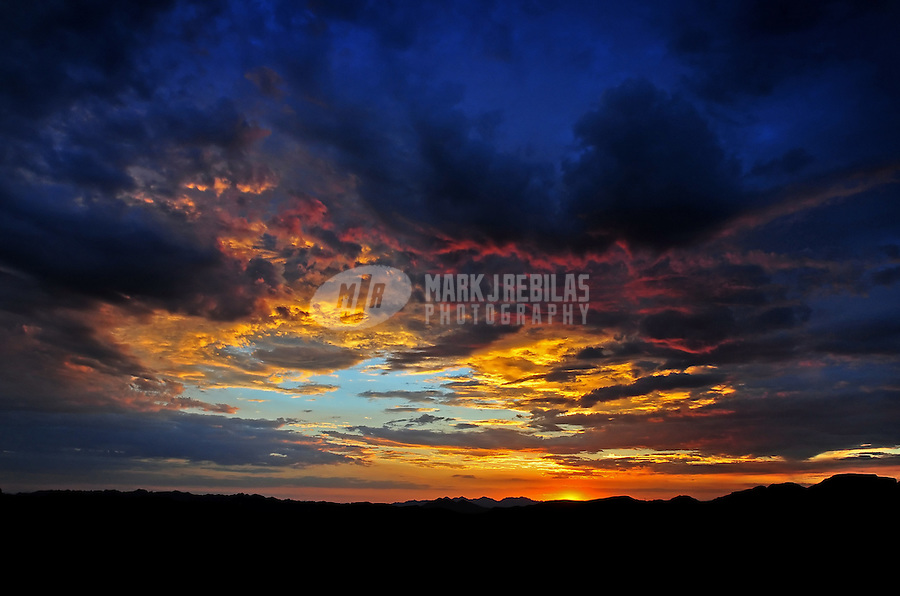 desert weather storm chaser chasing clouds sky Arizona mountain mountains sunset red orange