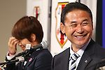(L-R)<br /> Aya Miyama, <br />  Norio Sasaki (JPN), <br /> JULY 7, 2015 - Football / Soccer : <br /> Japanese women's national football team head coach Norio Sasaki<br />  attends a press conference after arriving in Chiba, Japan. <br /> Japan lost the FIFA Women's World Cup Canada 2015 Final match against United States on July 5.<br /> (Photo by Shingo Ito/AFLO SPORT)