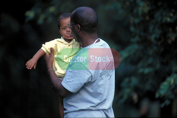 young father holding child
