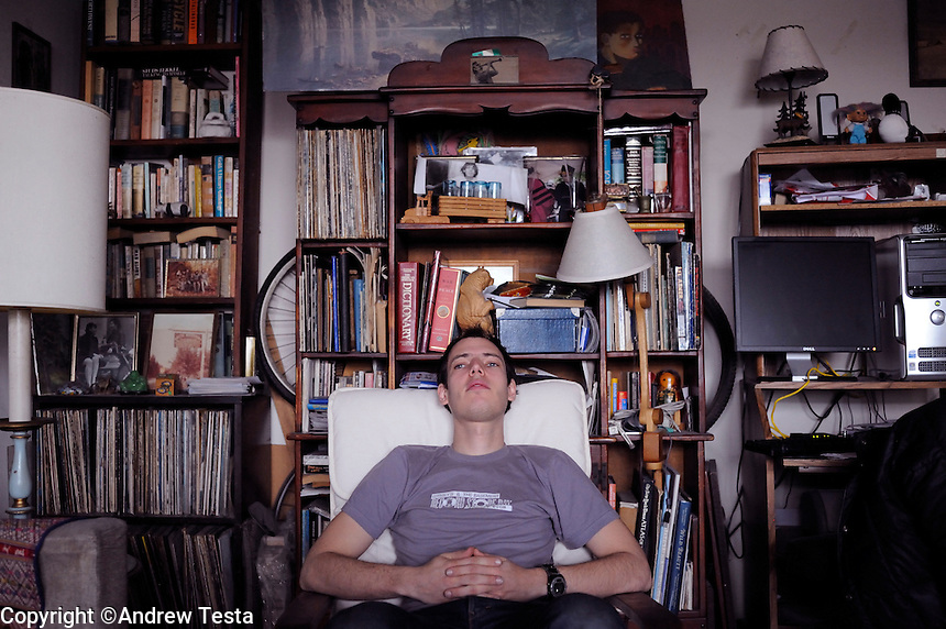 USA. Manhattan . 19th March 2009.Jeffrey Lewis in the apartment he grew up in on the lower east side in Manhattan..©Andrew Testa.
