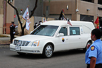 Phoenix, Arizona. July 7, 2013 - Nineteen hearses for each of the fallen members of the Granite Mountain Hotshots Arizona firefighting crew who died last week formed a procession to honor them in Phoenix as their bodies were taken back home to Prescott, about an 80-mile route. The body of Jesse Steed is carried inside this hearse that leaves the forensic science building toward Prescott. Photo by Eduardo Barraza © 2013