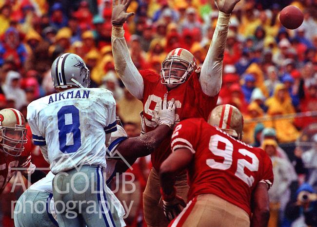 San Francisco 49ers vs. Dallas Cowboys at Candlestick Park Sunday, January 17,1993.  Cowboys beat 49ers 30-20.  Dallas Cowboys quarterback Troy Aikman (8) passes over San Francisco 49ers defensive end Dennis Brown (96).