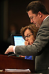 Nevada Assembly Democrats Debbie Smith and John Oceguera talk on the Assembly floor Monday, April 25, 2011, at the Legislature in Carson City, Nev. .Photo by Cathleen Allison