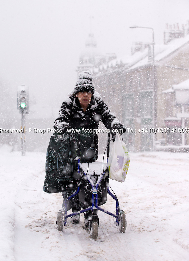 29/01/15<br /> <br /> A hardy pensioner pushes her wheeled-frame along a road in Buxton during a blizzard.<br /> <br /> Heavy snowfall results in multiple accidents, stranded vehicles and traffic chaos as the wintery weather does its best to shut down theDerbyshire Peak District town of Buxton.<br /> <br /> All Rights Reserved - F Stop Press.  www.fstoppress.com. Tel: +44 (0)1335 418629 +44(0)7765 242650