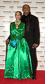 "Geoffrey Holder, right, and Carmen de Lavallade arrive at the Harry S. Truman Building (Department of State) in Washington, D.C. on December 4, 2004 for a dinner hosted by United States Secretary of State Colin Powell.  At the dinner six performing arts legends will receive the Kennedy Center Honors of 2004.  This is the 27th year that the honors have been bestowed on ""extraordinary individuals whose unique and abundant artistry has contributed significantly to the cultural life of our nation and the world"" said John F. Kennedy Center for the Performing Arts Chairman Stephen A. Schwarzman.  The award recipients are: actor, director, producer, and writer Warren Beatty; husband-and-wife actors, writers and producers Ossie Davis and Ruby Dee; singer and composer Elton John; soprano Joan Sutherland; and composer and conductor John Williams.<br /> Credit: Ron Sachs / CNP"