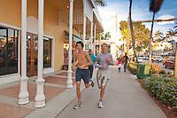 Joggers take a run along the historic Fifth Avenue South shopping district, Naples, Florida, USA. Photo by Debi Pittman Wilkey