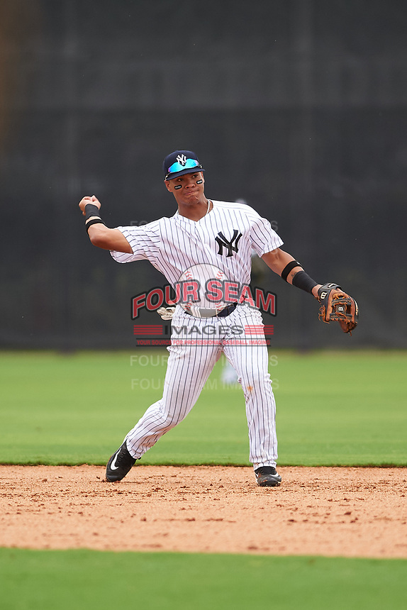 GCL Yankees East second baseman Jesus Graterol (6) throws to first base during the first game of a doubleheader against the GCL Yankees West on July 19, 2017 at the Yankees Minor League Complex in Tampa, Florida.  GCL Yankees West defeated the GCL Yankees East 11-2.  (Mike Janes/Four Seam Images)