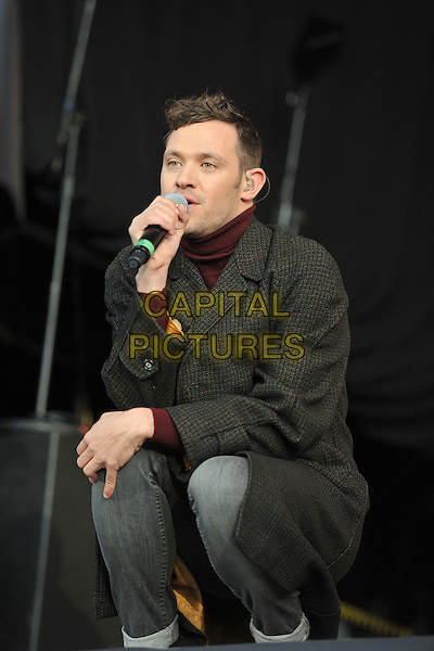 Will Young.At BBC Radio 2 Live in Hyde Park, London, England..September 11th, 2011.stage concert live gig performance music full length black coat singing crouching.CAP/MAR.© Martin Harris/Capital Pictures.