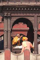 Pashupatinath, Nepal.  Sadhu, a Hindu Ascetic or Holy Man, Blesses a Worshipper.