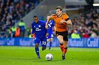 Ryan Bennett of Wolverhampton Wanderers is tracked by Junior Hoilett of Cardiff City during the Sky Bet Championship match between Cardiff City and Wolverhampton Wanderers at the Cardiff City Stadium, Cardiff, Wales on 6 April 2018. Photo by Mark  Hawkins / PRiME Media Images.