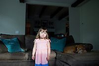 Elyse Bermont (age 2.5) stands in her family's living room in Lexington, Massachusetts, USA, on June 9, 2014. Both parents, Fred and Jen Bermont work during the day. Fred Bermont is getting ready to go to work and drop the kids off at day-care.