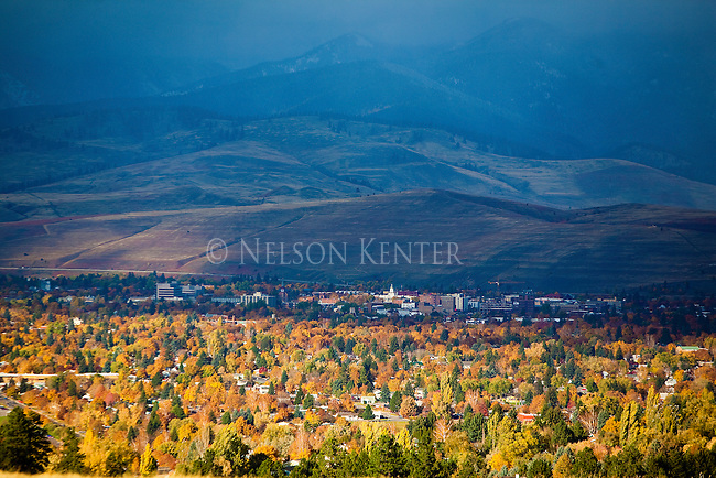 The Missoula, Montana valley in fall with a dark sky over the north hills