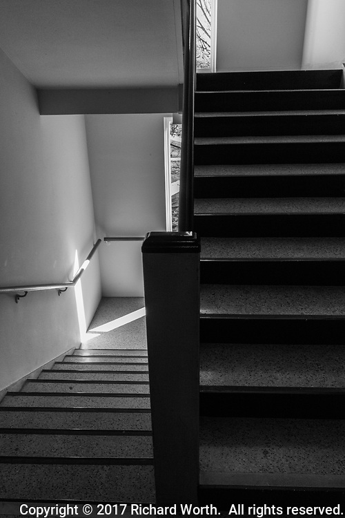 Lines of a stairwell with steps leading down and up, rendered in black and white.
