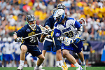 FOXBORO, MA - MAY 28: Brendan P. Smith (29) of the LImestone Saints runs past Dan Cotnoir (28) of the Merrimack Warriors during the Division II Men's Lacrosse Championship held at Gillette Stadium on May 28, 2017 in Foxboro, Massachusetts. (Photo by Larry French/NCAA Photos via Getty Images)