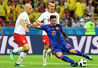KAZAN - RUSIA, 24-06-2018: Michal PAZDAN (Izq) jugador de Polonia disputa el balón con James RODRIGUEZ (Der) jugador de Colombia durante partido de la primera fase, Grupo H, por la Copa Mundial de la FIFA Rusia 2018 jugado en el estadio Kazan Arena en Kazán, Rusia. /  Michal PAZDAN (L) player of Polonia fights the ball with James RODRIGUEZ (R) player of Colombia during match of the first phase, Group H, for the FIFA World Cup Russia 2018 played at Kazan Arena stadium in Kazan, Russia. Photo: VizzorImage / Julian Medina / Cont