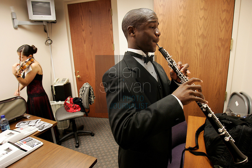 Oboist Korey Marshall (right) and violist Elena Urioste warm up in an office at Ebenezer Baptist Church Auburn Avenue in Atlanta before an Atlanta Symphony Orchestra performance on Sunday, July 29, 2007, a final event of the annual National Black Arts Festival.