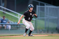 Landon Lassiter (2) of the Kannapolis Intimidators takes his lead off of third base against the Augusta GreenJackets at Intimidators Stadium on May 30, 2016 in Kannapolis, North Carolina.  The GreenJackets defeated the Intimidators 5-3.  (Brian Westerholt/Four Seam Images)