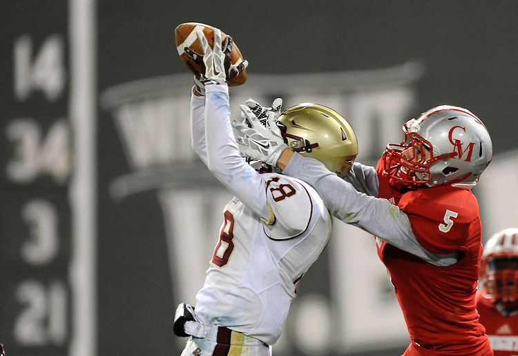 (Boston, MA, 11/25/15) Boston College High School's Bobby Demeo, left, intercepts the football in front of  Catholic Memorial's Mike Giacobee to preserve BC High's 13-10 lead late in the fourth quarter of a high school football game at Fenway Park in Boston on Wednesday, November 25, 2015. Photo by Christopher Evans