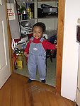 Young boy hiding in pantry