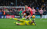 Lincoln City's Danny Rowe is fouled by Grimsby Town's James McKeown, resulting a red card for the Grimsby Town goalkeeper<br /> <br /> Photographer Chris Vaughan/CameraSport<br /> <br /> The EFL Sky Bet League Two - Lincoln City v Grimsby Town - Saturday 19 January 2019 - Sincil Bank - Lincoln<br /> <br /> World Copyright © 2019 CameraSport. All rights reserved. 43 Linden Ave. Countesthorpe. Leicester. England. LE8 5PG - Tel: +44 (0) 116 277 4147 - admin@camerasport.com - www.camerasport.com