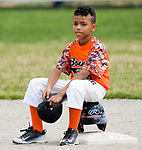 WATERBURY, CT-0712117JS07--Bonnie's player Isaiah Perez (16) takes a break at second base while Water-Oak's relief pitcher warms up during their consolation bracket game in the Roberto Clemente Tournament Thursday at the Waterbury PAL field. <br /> Jim Shannon Republican-American