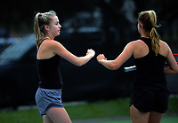 Antonia Kate Lawson (left) and Isabelle Coman. 2019 Wellington Tennis Open at Renouf Centre in Wellington, New Zealand on Thursday, 19 December 2019. Photo: Dave Lintott / lintottphoto.co.nz