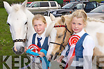 Twins Ava  and Amber Sugrue, Ballyseedy with their horses White Rose and Blondie at the Killorglin Pony show on Sunday..