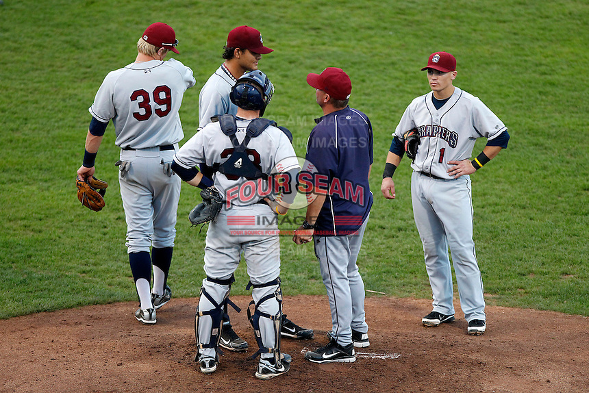 Mahoning Valley Scrappers pitching coach Greg HIbbard #36 in jacket talks with pitcher Elvis Araujo #50 as catcher Jake Lowery #38, Tony Wolters #1, and Jordan Smith #39 listen in during a game against the Jamestown Jammers at Russell E. Diethrick Jr Park on September 2, 2011 in Jamestown, New York.  Mahoning Valley defeated Jamestown 8-4.  (Mike Janes/Four Seam Images)