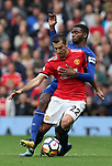 Cuco Martina of Everton tackles Henrikh Mkhitaryan of Manchester United during the premier league match at the Old Trafford Stadium, Manchester. Picture date 17th September 2017. Picture credit should read: Simon Bellis/Sportimage