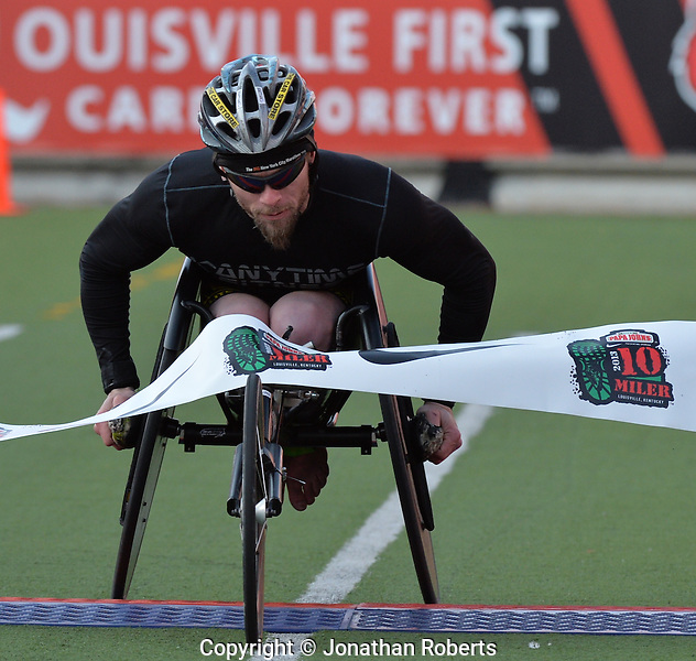Chad Johnson wins the wheelchair division of the Papa John's 10 Miler 2013. The Papa John's 10 Miler is the final leg of the Louisville Triple Crown of Running, presented by Novo Nordisk. Papa John's has sponsored the 10 Miler for 13 years. Photo by Jonathan Roberts