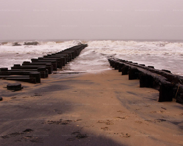 Parallel lines are made by an old beach retention wall and newer storm sewer flush line, both exposed by the surge and waves of the nor'easter spawned by the remnants of Hurricane Ida when it struck Rehoboth Beach, Delaware, in November 2009.