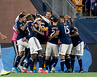 FOXBOROUGH, MA - SEPTEMBER 29: Teal Bunbury #10 of New England Revolution celebrates his goal with teammates during a game between New York City FC and New England Revolution at Gillette Stadium on September 29, 2019 in Foxborough, Massachusetts.