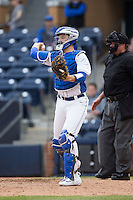 Duke Blue Devils catcher Cris Perez (18) makes a throw to third base against the California Golden Bears at Durham Bulls Athletic Park on February 20, 2016 in Durham, North Carolina.  The Blue Devils defeated the Golden Bears 6-5 in 10 innings.  (Brian Westerholt/Four Seam Images)