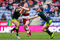 Picture by Alex Whitehead/SWpix.com - 11/03/2018 - Rugby League - Betfred Super League - Wigan Warriors v Wakefield Trinity - DW Stadium, Wigan, England - Wigan's George Williams escapes the attempted tackle by Wakefield's Danny Kirmond and Anthony England.