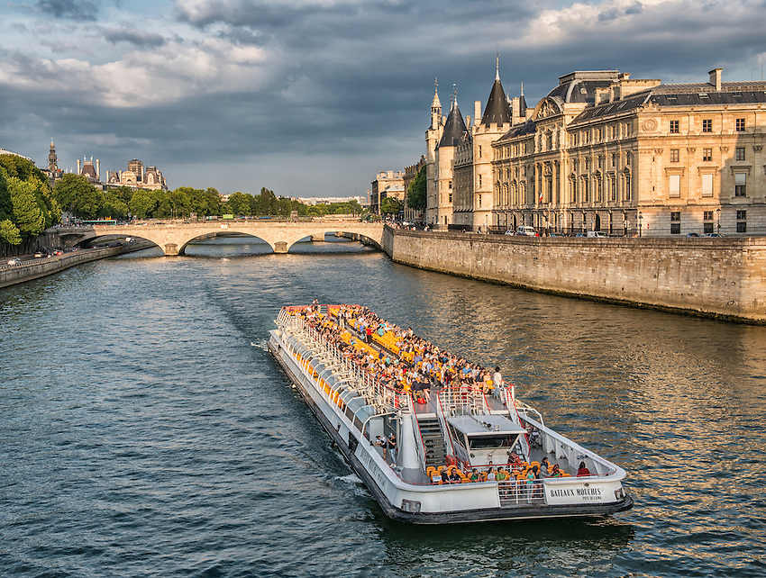A view to the east along the Seine in late afternoon, as seen from the Pont Neuf. The Conciergerie is visible on the right.