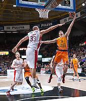 VALENCIA, SPAIN - 05/12/2014. Blazic, Zirbes del Estrella Roja y Vives del Valencia Basket durante el partido. Pabellon Fuente de San Luis, Valencia, Spain.