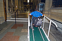 Wheelchair person using the ramp and handrails to gain access to the church. This image may only be used to portray the subject in a positive manner..©shoutpictures.com..john@shoutpictures.com
