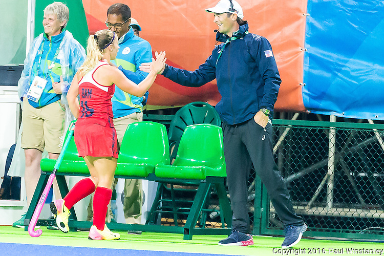 Katie Bam #16 of United States is congratulated on scoring a hat trick by coach Craig Parnham during USA vs Japan in a Pool B game at the Rio 2016 Olympics at the Olympic Hockey Centre in Rio de Janeiro, Brazil.