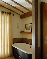 The roll-top bath is easily accomodated in this well appointed but small bathroom