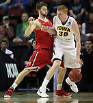 Davidson's Tyler Kalinoski (4) defends  Iowa's Aaron White (30)  during the 2015 NCAA Division I Men's Basketball Championship's March 20, 2015 at the Key Arena in Seattle, Washington.  Iowa beat Davidson 83-52.        ©2015. Jim Bryant Photo. ALL RIGHTS RESERVED.