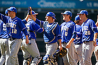 The Kentucky Wildcats celebrate their 2-1 win over the Utah Utes at Minute Maid Park on March 6, 2011 in Houston, Texas.  Photo by Brian Westerholt / Four Seam Images