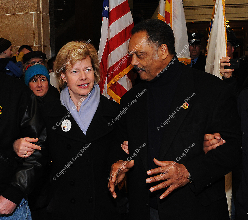 US Representative Tammy Baldwin talks to Rev. Jesse Jackson at the Wisconsin State Capitol in Madison during a rally protesting Wisconsin Governor Scott Walker's changes to state union laws