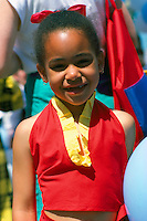 Portrait of Young African American Girl wearing Red and Yellow Dress with Red Bow in her Hair (No Model Release Available)